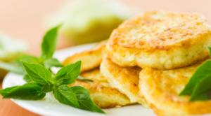 Stack of squash pancakes garnished with basil